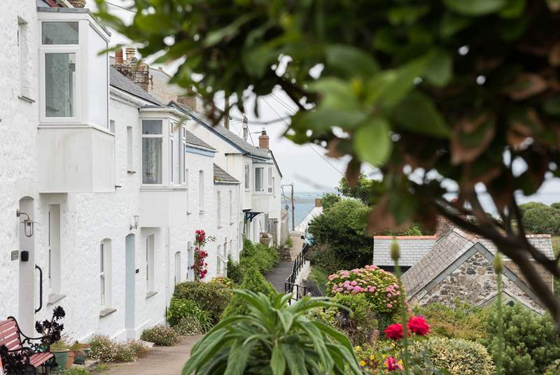 The path to the front of the cottage leads you down to the pub, village shops, cafe and of course the beach.