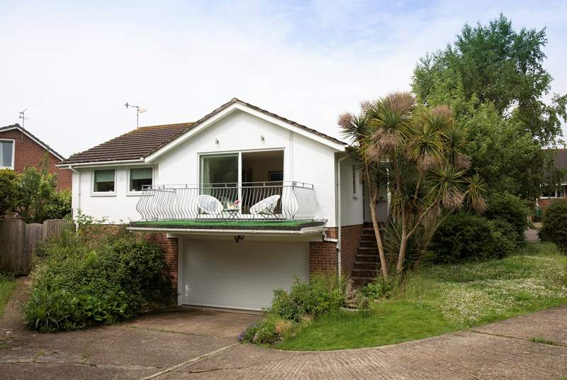 In a secluded plot within a few minutes walk of Seagrove Bay (please note there are several steps up to the front door).