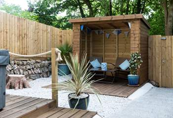 The rear terrace with hot tub.