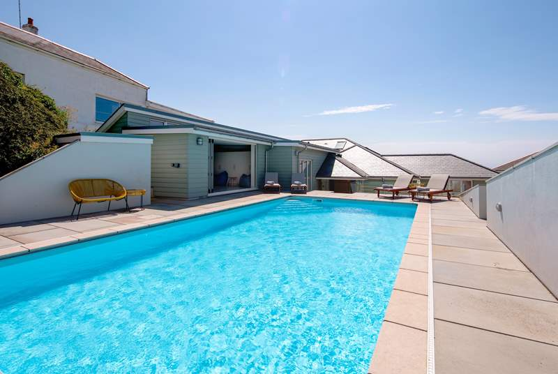 The outdoor heated pool is so inviting and will prove a huge hit with the whole family.