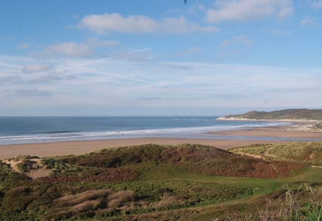 North Devon has some incredible sandy surfing beaches as well as the cliffs and rocky coves. This is Woolacombe.