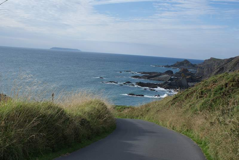 Lundy Island is in the distance. You can take a boat trip out to this very special bird sanctuary from Bideford.