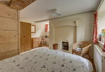 Another view of the ground floor bedroom with its  ornamental feature fireplace.