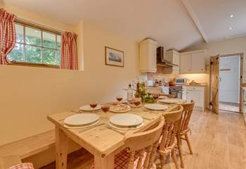 There is a lovely farmhouse dining table with plenty of space for all eight guests at The Bear.