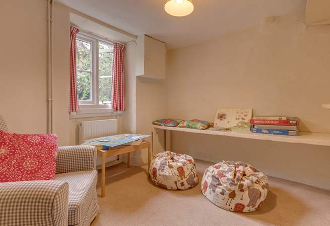 There is a snug off the hallway too - an ideal hideaway for children to spread out their toys or play games.