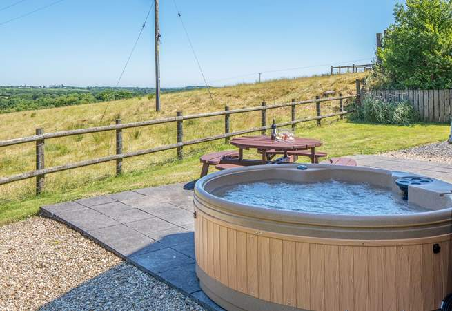 What incredible views to enjoy from your private hot tub in the fully enclosed patio and garden area.