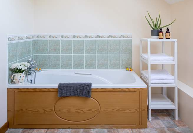 The bath in the family bathroom is perfect for relaxing and unwinding following a full day of adventure.