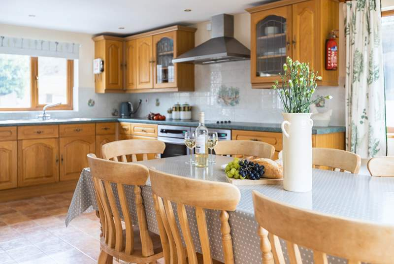 The kitchen diner is a spacious room with a well equipped kitchen, with patio doors out on to the side garden.
