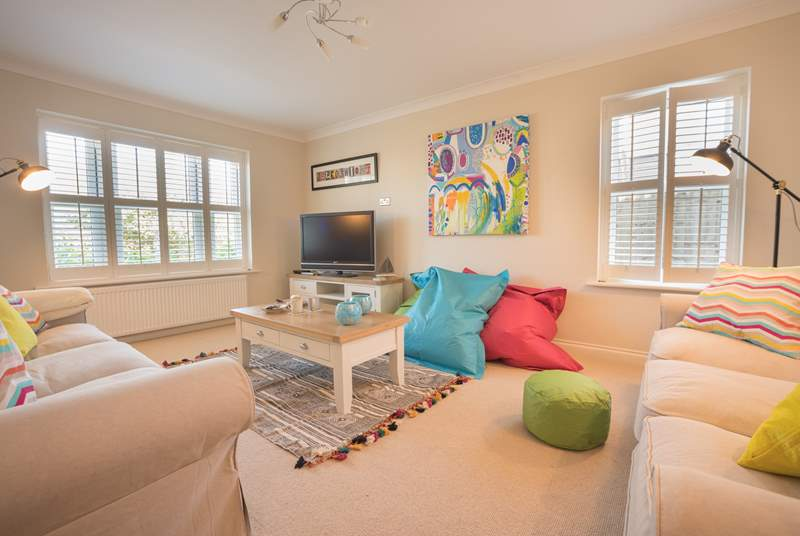 The sitting-room is furnished and decorated to a high standard
