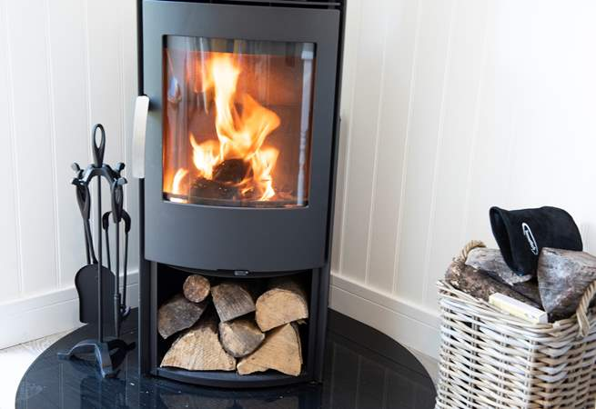 There is under-floor heating throughout and a cosy wood-burner for those chillier months.