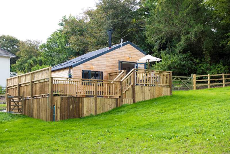Bespoke built and overlooking the meadow (where you are welcome to roam with your four-legged friend) there is a huge wooden deck to enjoy too,