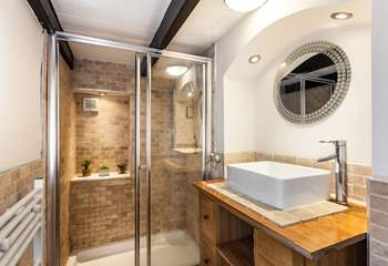 The downstairs shower-room, is perfect to wash away the sand.