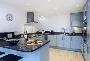 The stylish kitchen is fabulously equipped.