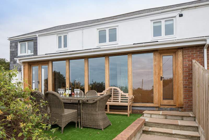 The fabulous glass front to this house offers the most spectacular views from the beautiful open plan living areas.