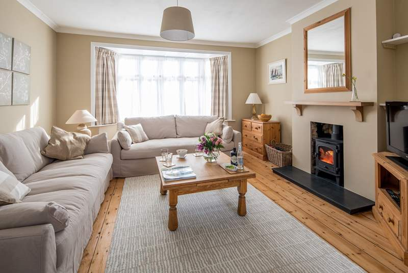 Two large comfy sofas and a cosy wood-burner invite you to relax.