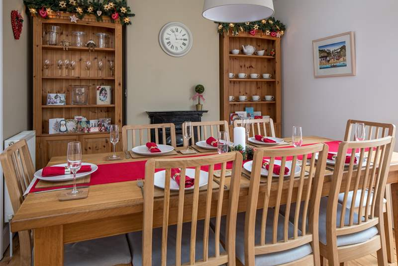 The dining table seats 8 comfortably, perfect for a family Christmas.