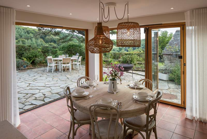 The fabulous bi-fold doors fully open to enhance your dining experience to the maximum.