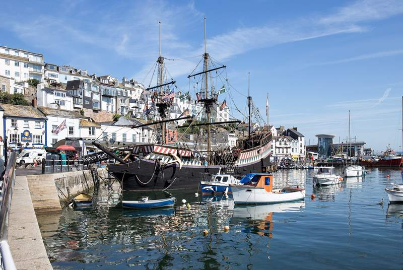 The Golden Hind floats proudly on centre stage in the harbour.