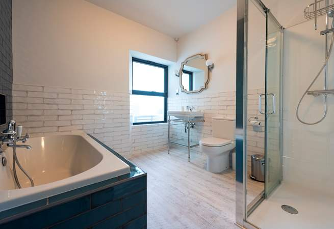 The bathroom is fab and wonderfully spacious with beautiful tiles, a double ended bath and large shower.