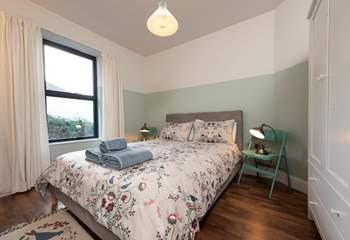 Pretty linens in Bedroom 3.