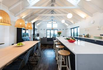 The island provides oodles of space when preparing meals and provides a natural divide between the dining-area and kitchen.