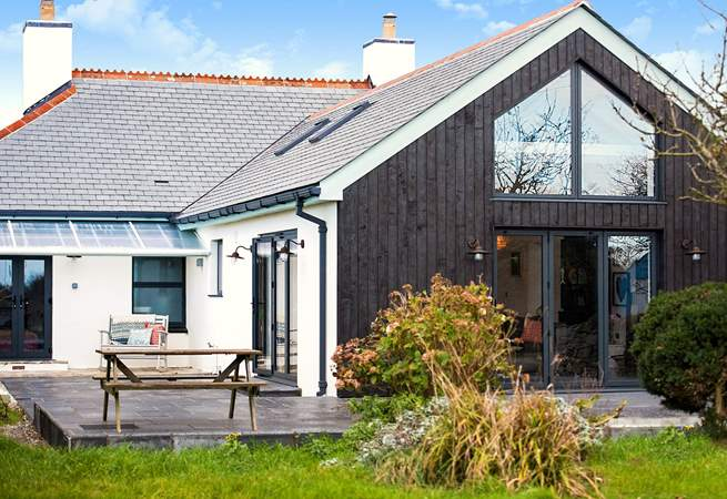 The impressive extension sits at the back making the most of the setting.