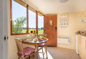 The separate cabin houses a well-equipped kitchen-area, en suite shower-room and a pretty little table and chairs for eating with a view.