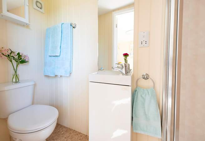 The shower-room is complete with electric hot shower and proper flushing WC.
