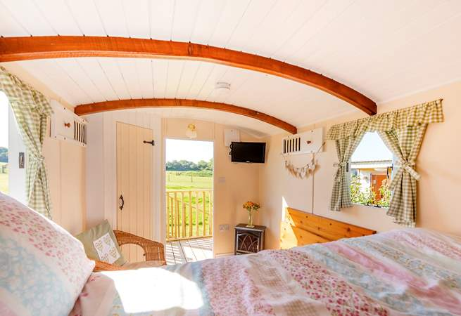There's a comfortable double bed, country-style furnishings and a small TV but you'll probably want to gaze out over the meadow and fields beyond.