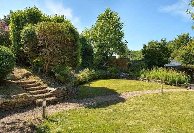 There are different areas to discover around the garden and a bubbling hot tub to boot!