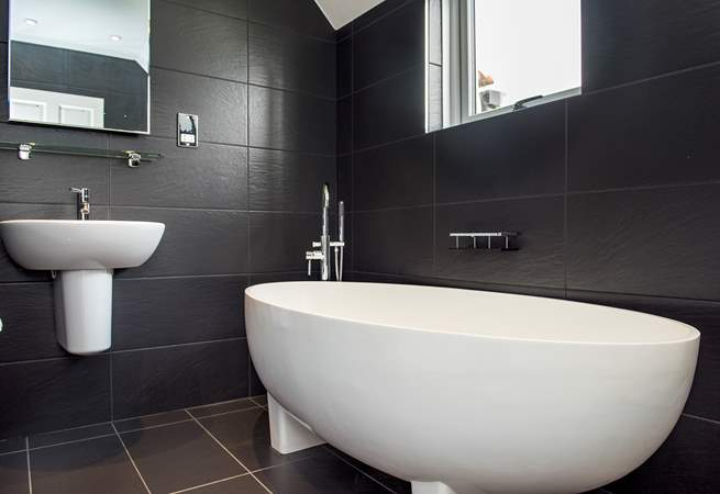 Want to treat yourself to a nice long soak whilst you are away? There is also a family bathroom with a super stylish free-standing bath.