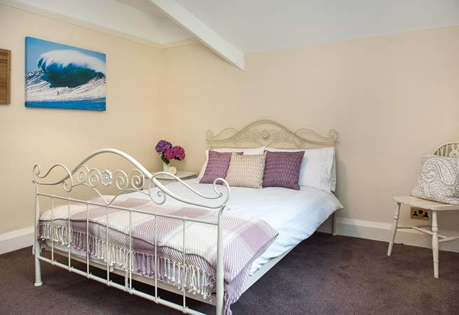 There's a pretty bedstead for the double bed in bedroom 4...