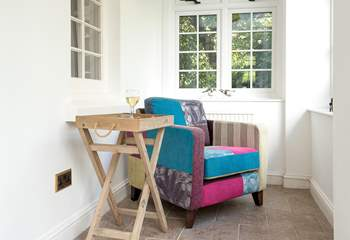 Enjoy some quiet time perhaps with a good book in the sun-room.