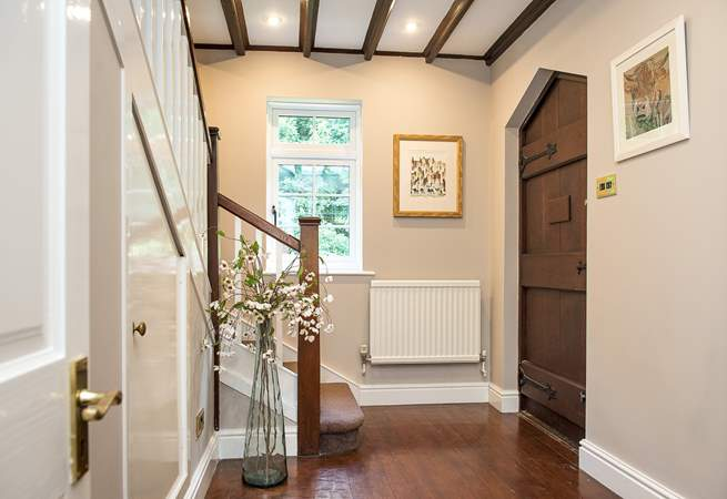 The entrance hall provides a warm welcome.