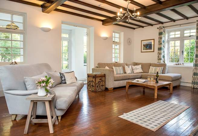 The triple-aspect sitting-room is wonderfully light and airy.