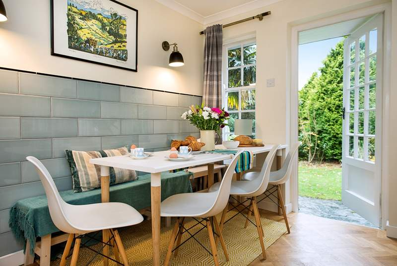 Enjoy breakfast in the large kitchen with the door thrown open to the private garden.