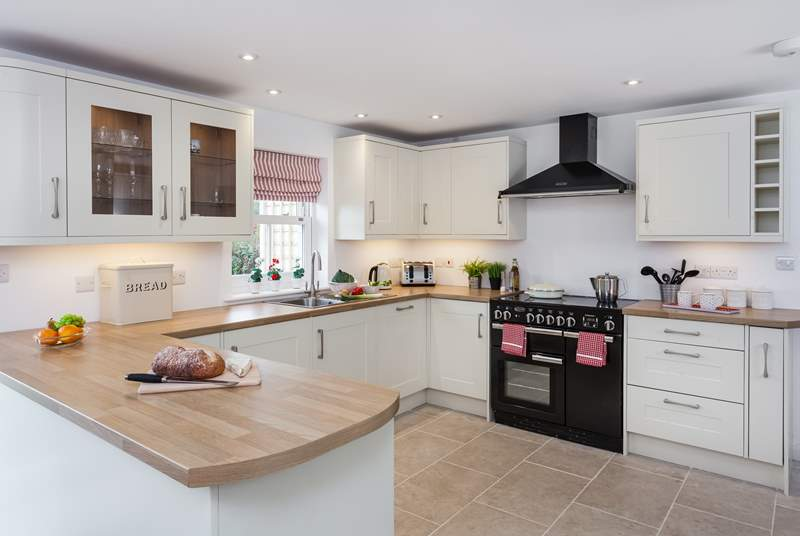 The kitchen boasts a range cooker and also overlooks the garden.