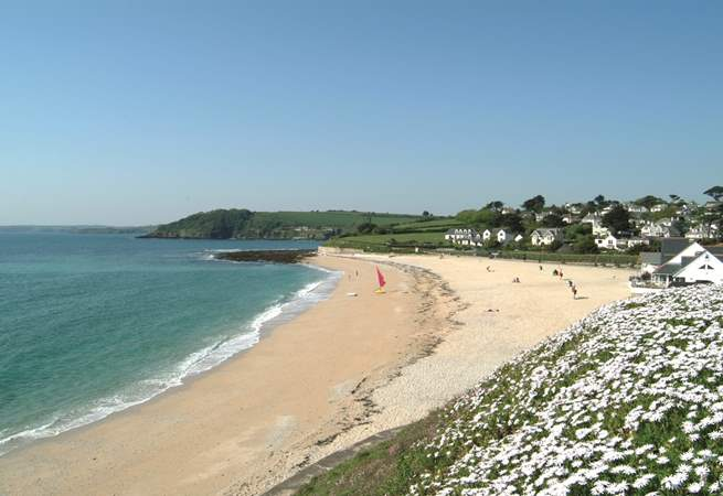 Sandy Gyllyngvase beach in Falmouth has a great beach cafe, restaurant and paddleboard hire.