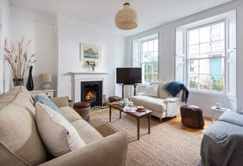 The light sitting-room with a cosy open fire.