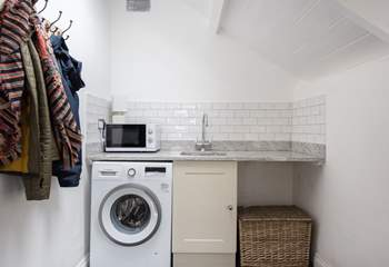 The utility-room is the perfect place for beach towels or muddy boots.