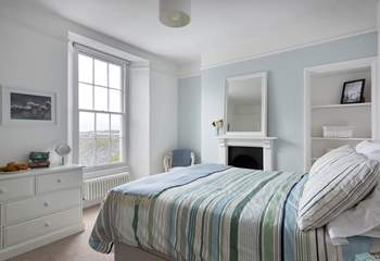 This bedroom is at the back of the house with views up Penryn River.