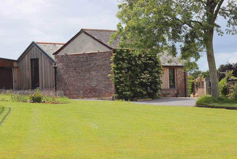 The Old Stables awaits you at the end of the drive. Please park up to the left of the property and prepare to be wowed!