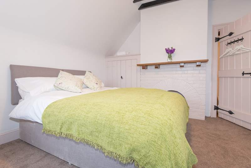 Bedroom four, another zip and link king-size or twin beds, also on the first foor to the rear of the property and overlooking the garden