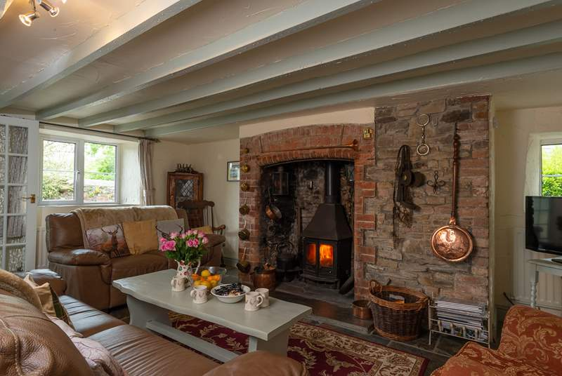 The living room with the inglenook fireplace is at the heart of the cottage