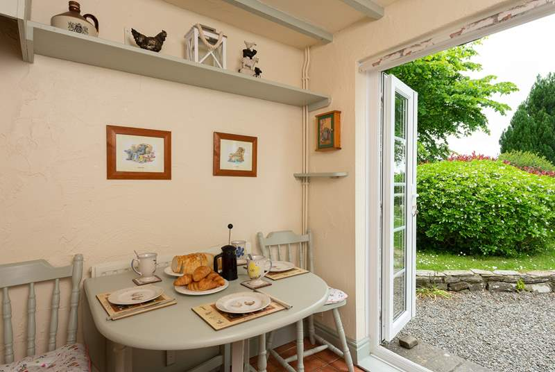 French windows lead from the kitchen/breakfast-room straight out into the large garden.
