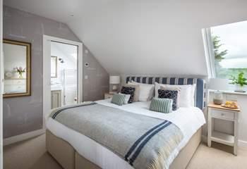 The bedroom on the first floor has an en suite shower room (Bedroom 3).