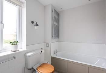 Enjoy a soak in the family bathroom.