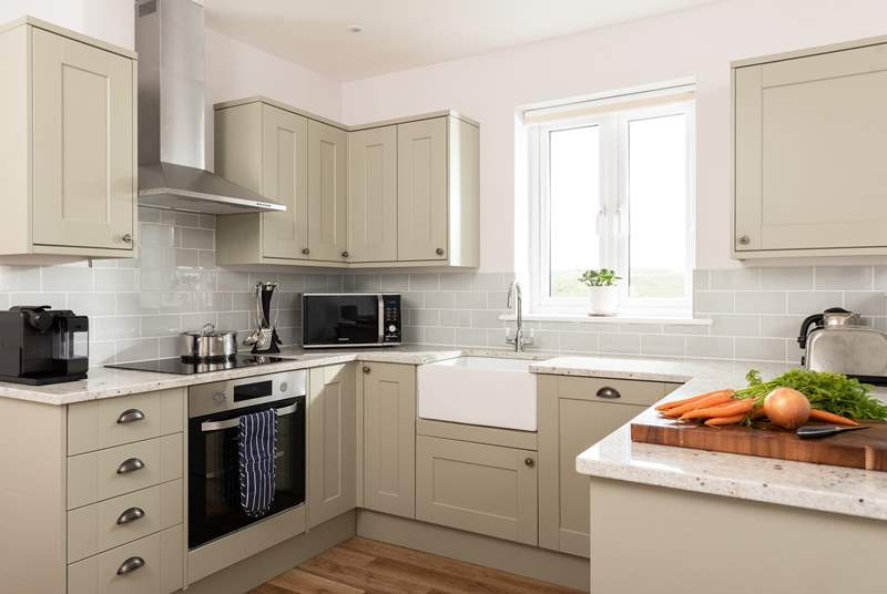 The kitchen is a lovely space to prepare a feast, wash up with a view.