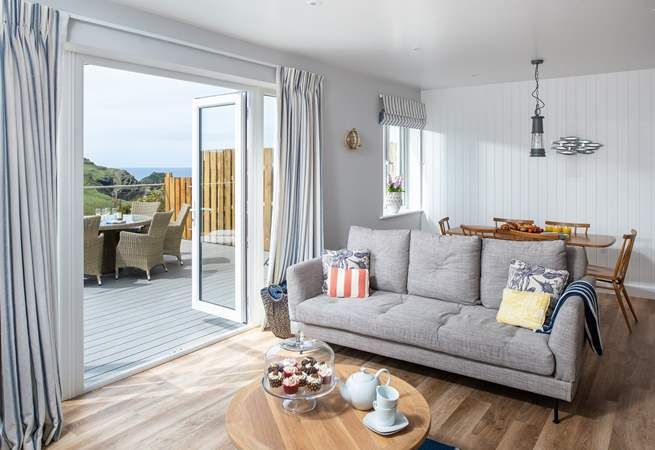 The open plan living space opens to the large terrace.