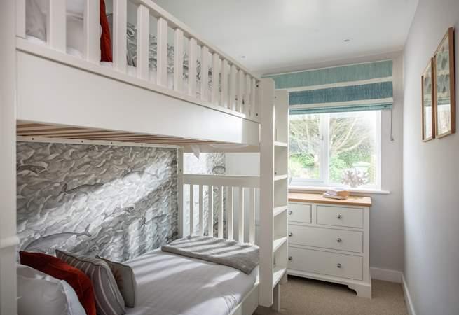 The bunk bedroom has really fun wall paper (Bedroom 3).